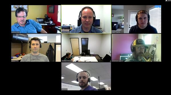 Zoom grid with one participant in a meeting room